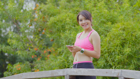 Woman use of smart watch and cellphone Banque d'images