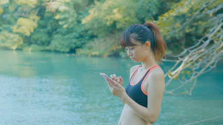 Woman use of smart cellphone in park