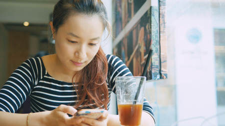 young Asian woman using smartphone Stok Fotoğraf - 93284716