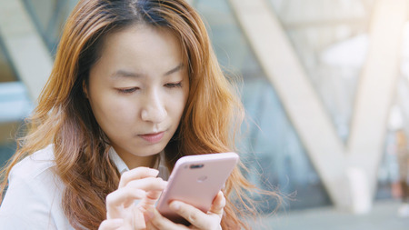 Businesswoman touching on cellphone in office