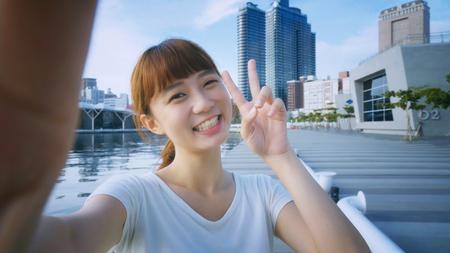 Asian girl using smart phone selfie
