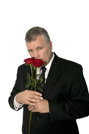A handsome middle-aged man holding roses. Stock Photo
