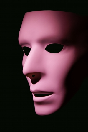 Pink mask taken against a black background  Stock Photo - 15397267