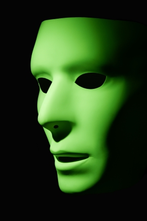Lime green mask with large black eyes Stock Photo - 15397269