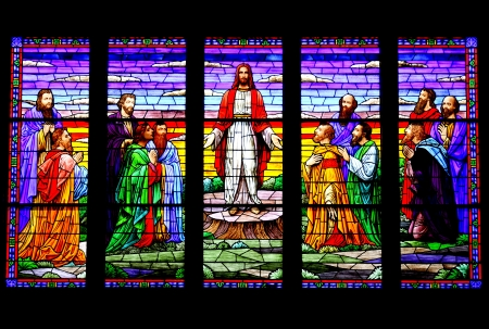 followers: Stained glass window depicting Jesus and his followers. Stock Photo
