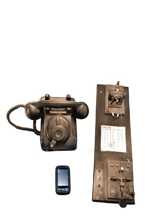 A vintage telephone and telegraph plus a cell phone with space for text on the top. Reklamní fotografie