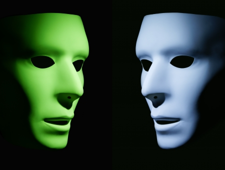 One green mask and one light blue mask facing each other  Imagens