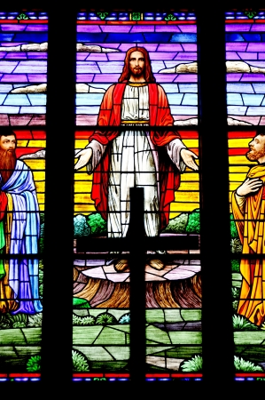 catholic stained glass: Jesus with his arms spread out on a stained glass window.