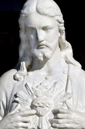 Standbeeld van Jezus wijst naar zijn hart Stockfoto