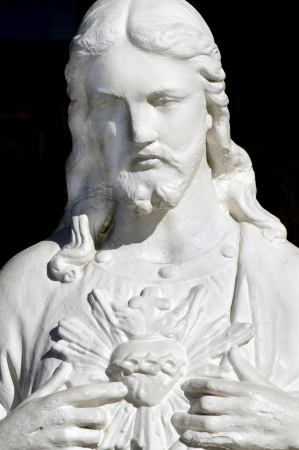 Statue of Jesus pointing to his heart  photo