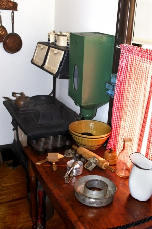 Old antique kitchen complete with stove, table and baking equipment  photo