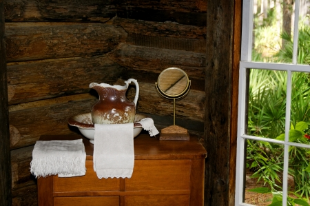 Antique wash basin and dresser with towels and a mirror. Stock Photo - 16757705