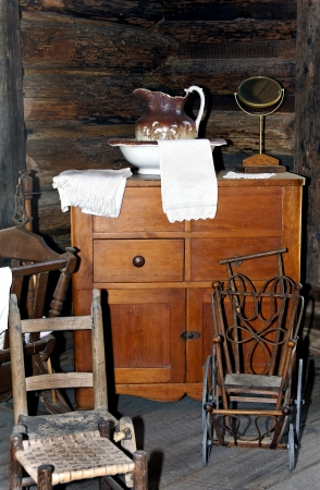 Antique wash basin, dresser, baby stroller, chair and crib Stock Photo - 16986353