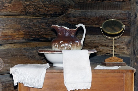 Antique pitcher and wash basin with two white towels. Stock Photo - 16986332