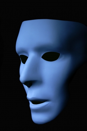 Side view of a blue ghost like face against a black background.