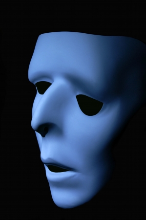 ghostly: Blue ghostly face that has been distorted to appear sad.