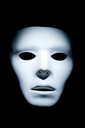 apparition: Haunting appearance of a white ghost like face against a black background.
