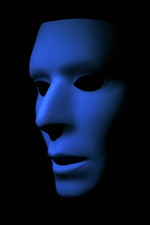 Dark blue ghostly face with large black eyes.