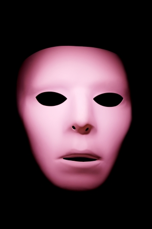 Pink ghost like face with big eyes against a black background. Stock Photo