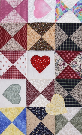 Different color hearts in a beautiful romantic quilt. photo