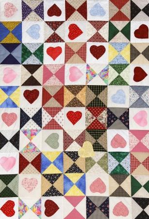 Romantic beautiful colorful heart motif quilt blanket. photo