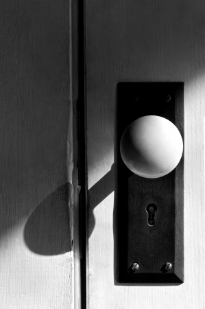 door knob: Closeup white and black antique door knob.