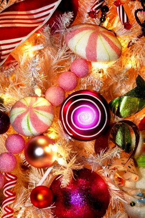 Assorted colorful decorations on a Christmas tree.