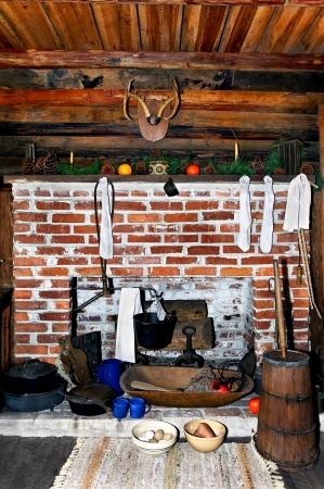Old log cabin fireplace at Christmas time with stockings.
