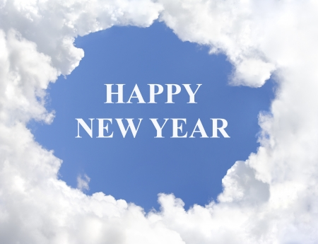 Puffy white clouds with  Happy New Year  in the middle