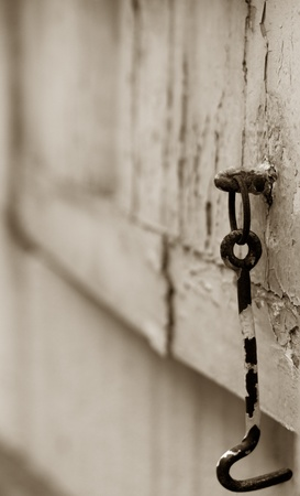 Old window hook on wooden window frame that has been split toned photo