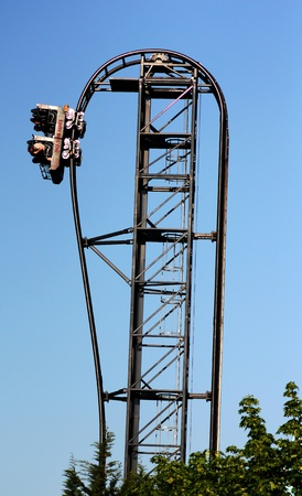 Image of a dark roller coaster on a blue background photo