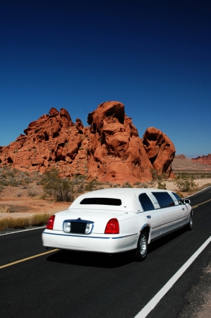 White limousing driving in the desert by the Valley of Fire Nevada Stock Photo - 6970305