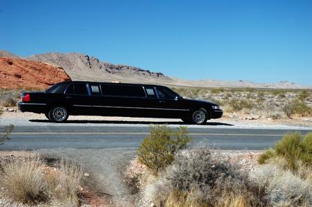 Black limousine in the desert. photo