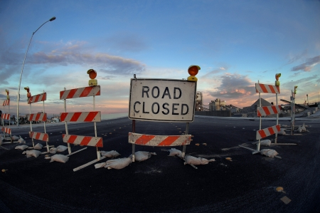 closure: Road closed sign and barricade to an industrial area. Stock Photo