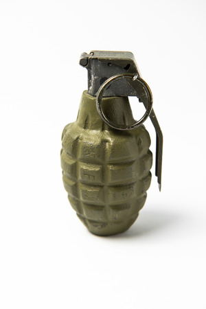 A army green hand grenade of the pineapple type. Green with pin and lever. On white background. Imagens