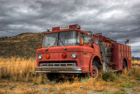 Old retro abandoned red fire engine.
