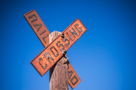 Old vintage railroad crossing sign.