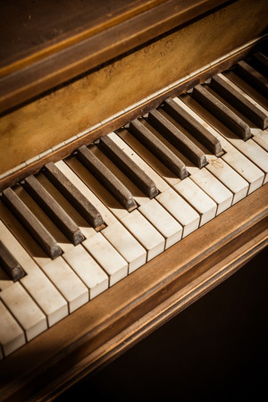Dusty keys of an old antique piano.