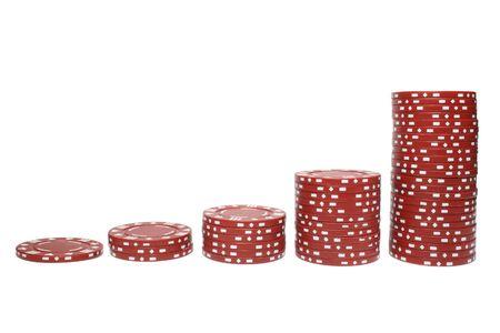 Poker chip stacks increasing in size. photo