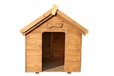 A wooden dog house with a wooden bone above the door.