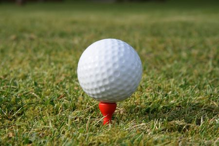 A golf ball on a red tee waiting to be hit. Stock Photo - 912651