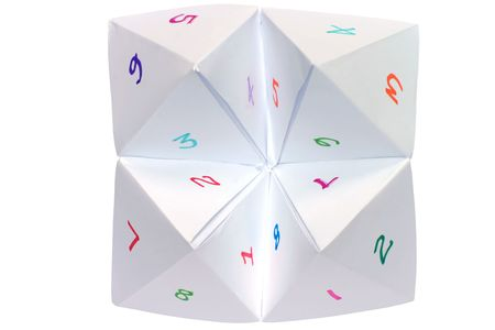 A childs cootie catcher with colorful numbers Stock Photo