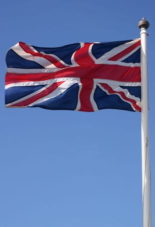 The Union flag (Union Jack) blowing in the wind on a sunny day photo