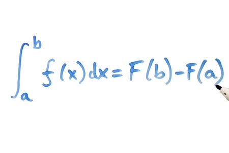 Writing a mathematical equation on a whiteboard. photo