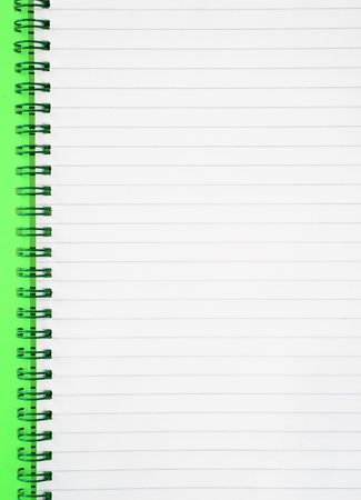 An open spiral notepad with blank lined paper. photo