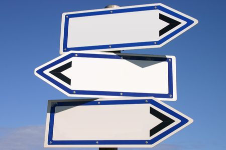 Blank three-way direction signpost with a blue sky background photo