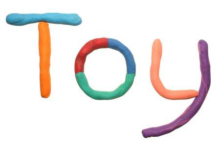 Toy, written in bright colored plasticine photo