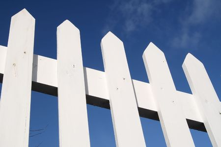 picket fence: White picket fence and a blue sky. Stock Photo