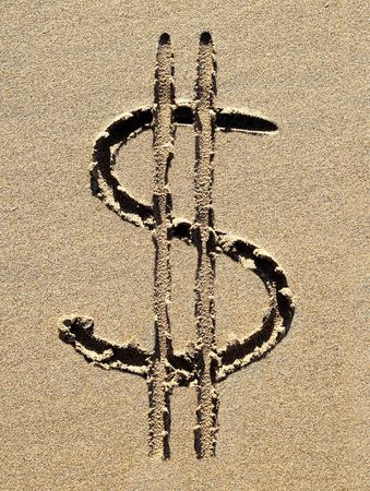 sand dollar: Dollar symbol drawn in the sand. Stock Photo