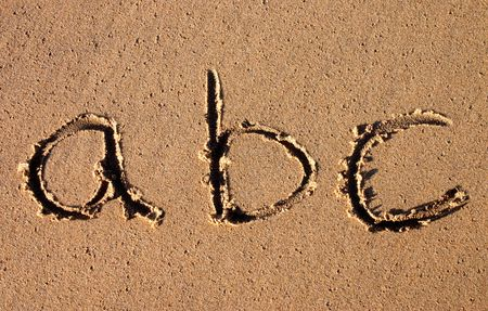 abc written in the sand on a beach. photo
